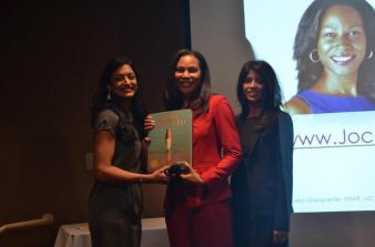 Jocelyn Giangrande receiving honor from Directors Kirti Surati and Jagruti Panwala-AAHOA